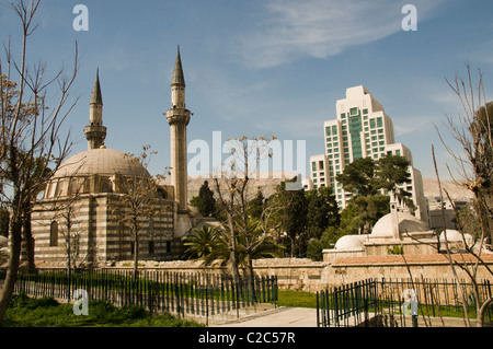 Four Seasons Hotel and Takiyya as Suleimaniyya a turkish style mosque Damascus Town City Syria Syrian - Stock Photo