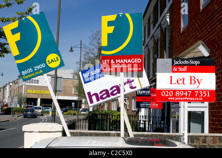 Property boards outside apartment block, Wimbledon South London. - Stock Photo