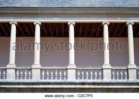 Antique passage of columns in San Lorenzo del Escorial's Abbey. Madrid. Spain - Stock Photo