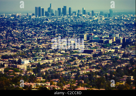 Los Angeles urban sprawl & downtown skyline as seen from a distance from scenic overlook at Griffith Observatory - Stock Photo