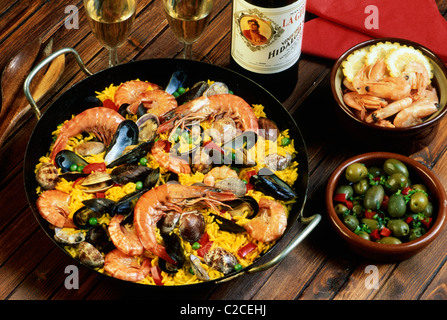 Paella is a rice dish, originally from Valencia, Spain, where it is traditionally eaten on Sundays. It is generally cooked in a Stock Photo