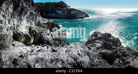 Rocky shoreline Stradbroke Island Queensland Australia - Stock Photo