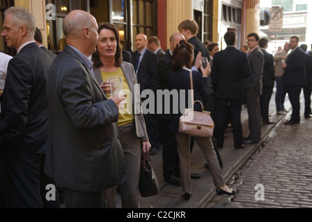 City office business men women office workers lunch time drink. Leadenhall Market City of London EC3 UK. - Stock Photo