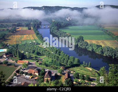 Aerial view of French agriculture farmland in countryside landscape with mist low cloud over the Dordogne river - Stock Photo