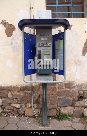 Public blue and gray phone in Peru - Stock Photo