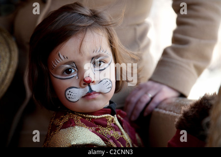 Three year old girl child with face paint, Venice, Italy Europe - Stock Photo