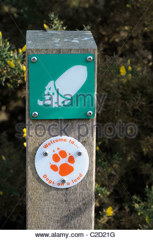 Close up image of a trail marker and dog owners sign on a post at Arne in Dorset, England - Stock Photo