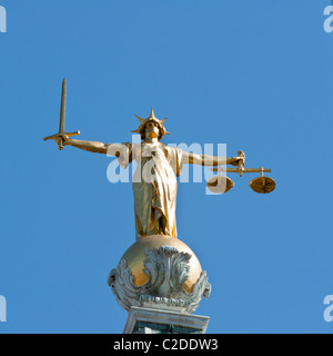 The Scales of Justice statue on the dome of the Old Bailey central criminal court. London. - Stock Photo