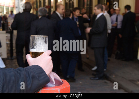 Office workers lunchtime drink outside city pub City of London UK  HOMER SYKES - Stock Photo