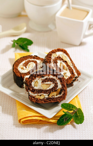 Chocolate Swiss roll with walnuts. Recipe available. - Stock Photo