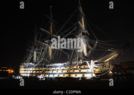 The old warship, man of war sailing ship HMS Victory, floodlit at night. - Stock Photo