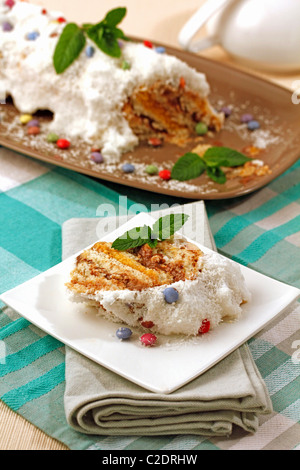 Snowed Swiss roll. Recipe available. - Stock Photo