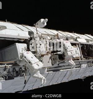 Astronauts working on International Space Station - Stock Photo