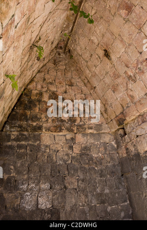 Interior room with vaulted ceiling in El Palacio or The Palace at the Puuc style Maya ruins of Kabah in the Yucatan, - Stock Photo