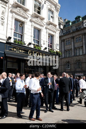 City workers drinking at lunchtime outside pub, London - Stock Photo
