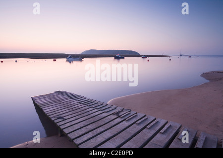 Wooden Jetty on the River Axe with Brean Down in the Distance. Somerset. England. UK. - Stock Photo
