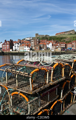 Fishing Creels Lobster Pots   Harbour view of Whitby in the Borough of Scarborough, North Yorkshire, UK - Stock Photo