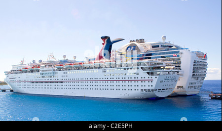 Cozumel, Mexico - December 8th 2010: Two large cruise ships tied to pier. - Stock Photo