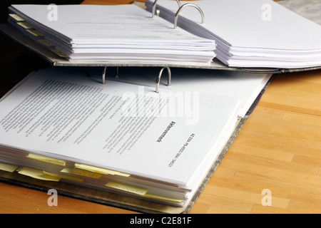 Office, files, person looks through a document file. - Stock Photo