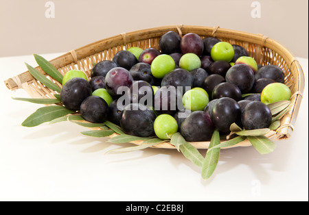 Freshly picked olives in a basket - Stock Photo