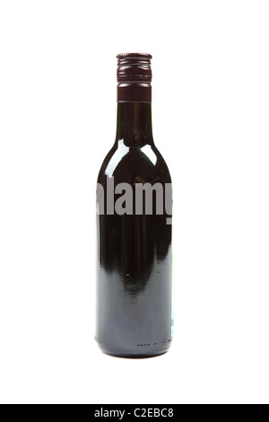 Small size full bottle of red wine isolated on white background. - Stock Photo