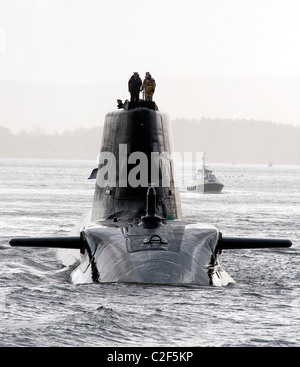 HMS Astute, the Royal Navy's latest nuclear submarine sail up Gareloch on the Firth of Cylde to her new base at - Stock Photo