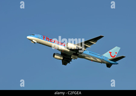 Thomson Boeing 757 aircraft taking off at Birmingham Airport, UK - Stock Photo