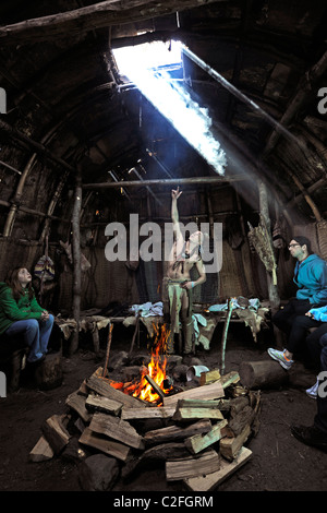 Plimouth Plantation. Brave talks about native people's lives in 1600's in recreated Wampanoag village - Stock Photo