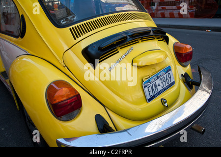 A classic Volkswagen Beetle parked in the street in downtown Manhattan, New York City - Stock Photo
