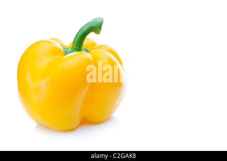 Isolated sweet yellow bell pepper (Capsicum annuum) on white background. - Stock Photo