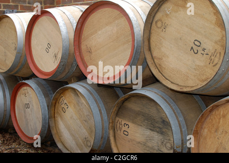 oak barrels stacked top. Stack Of Oak Barrels Used For Wine. Outside Vineyard In Surrey. England - Stock Stacked Top