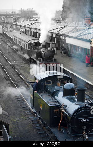 Steam trains at the Great Central railway at Loughborough station, including the GWR 1450 restored locomotive - Stock Photo