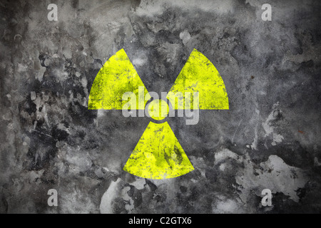 Concrete wall with yellow radiation sign - Stock Photo