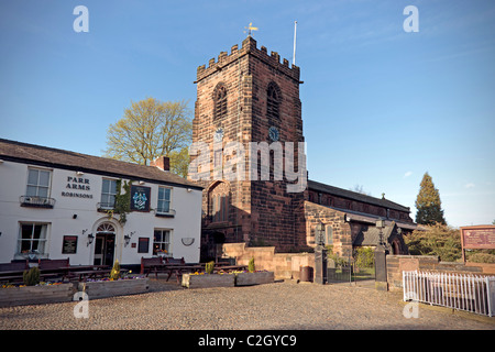 Grappenhall village with St. Wilfrid's church and Parr Arms public house. - Stock Photo