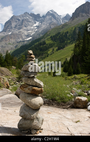 Stacked stones in front of the Jungfrau mountain, Lauterbrunnental, Switzerland - Stock Photo