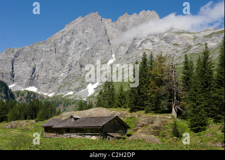 An alpine cabin in the Lauterbrunnen Valley, Switzerland - Stock Photo