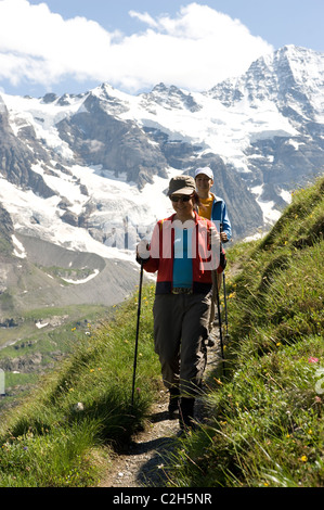 Hikers on a mountain slope, Lauterbrunnental, Switzerland - Stock Photo