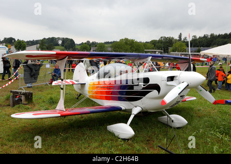 Small modern, acrobatics plane used for displays at the Airshow '100 years Swiss aviation' July 24, 2010 in Emmen, - Stock Photo