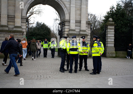 An Garda Siochana outside the entrance gates of St Stephens Green, Dublin, Ireland on St. Patrick's Day. - Stock Photo
