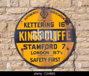 Vintage AA road sign on the wall of a former public house in King's Cliffe, Northamptonshire, England - Stock Photo