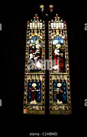 stain glass window church light colour dark surround religious picture story gospel saints god jesus almighty lead - Stock Photo