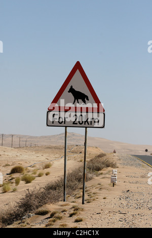 Road sign warning against Hyenas in Namibia - Stock Photo