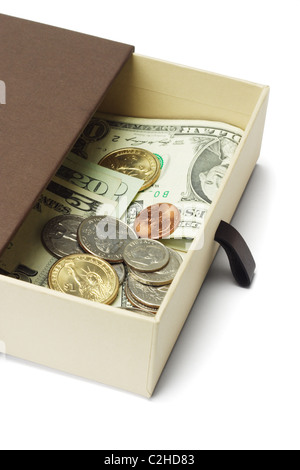 US dollar notes and coins in brown gift box on white background - Stock Photo
