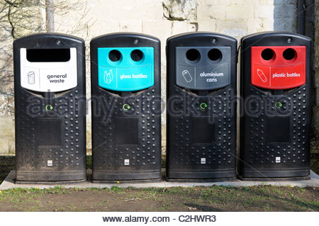 Straight on image of four separate materials recycling bins in England, UK - Stock Photo