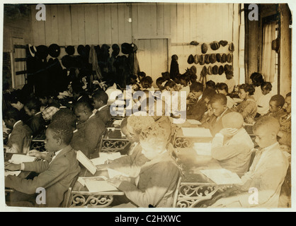 75 Sixth Grade children (colored) crowded into 1 small room in an old store building near Negro High School, with - Stock Photo