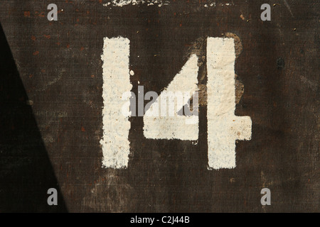 White Painted Number 14 On Wood - Stock Photo