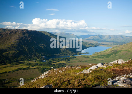View over Kylemore Lough from the summit of Diamond Hill, in the Twelve Ben Mountains. Connemara National Park, - Stock Photo