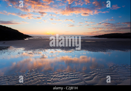 Evening beach reflections in False Bay, Connemara, County Galway, Ireland. - Stock Photo