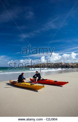 Sea kayakers resting in False Bay, Mannin Bay, Connemara, County Galway, Ireland. - Stock Photo