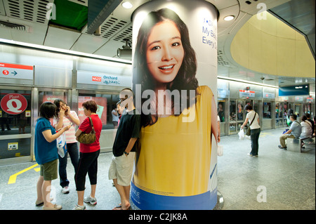 Striking advertising in Singapore's Mass Rapid Transit (MRT) metro system. Here at Orchard Station on the North - Stock Photo